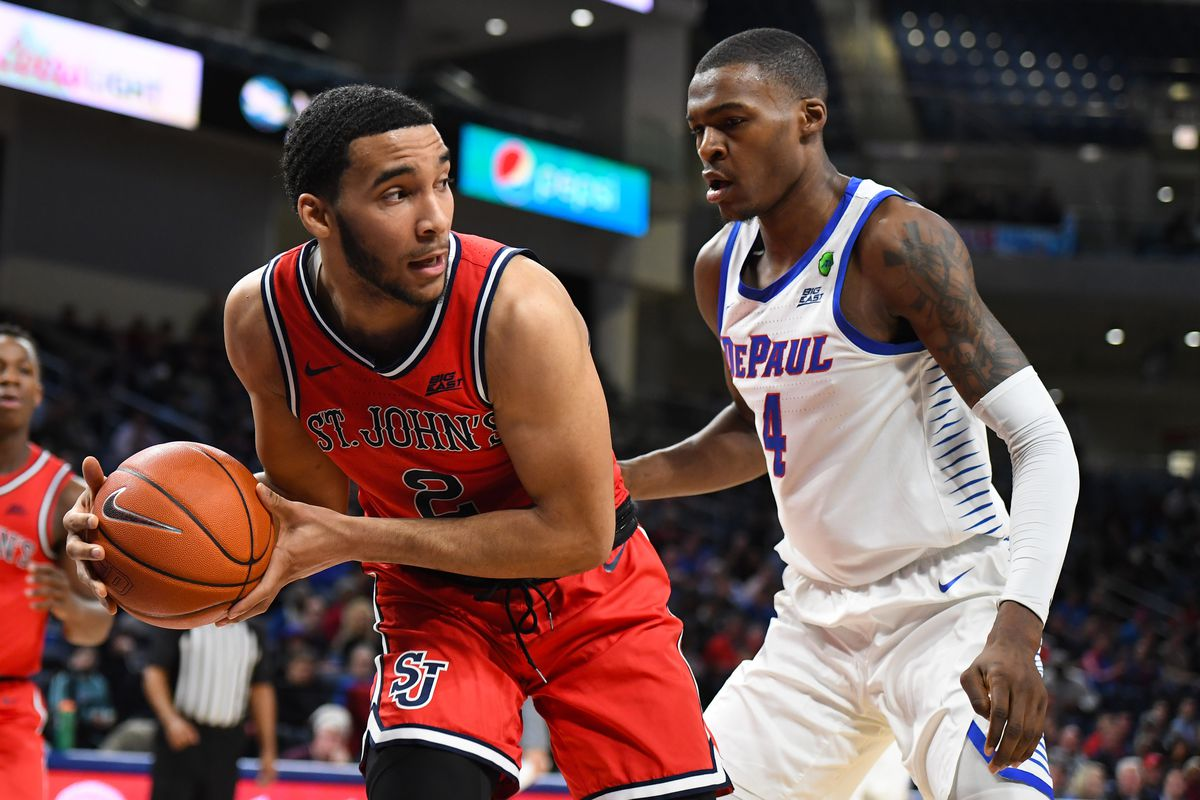St. John's Red Storm guard Julian Champagnie grabs a rebound against DePaul Blue Demons forward Paul Reed during the second half at Wintrust Arena.