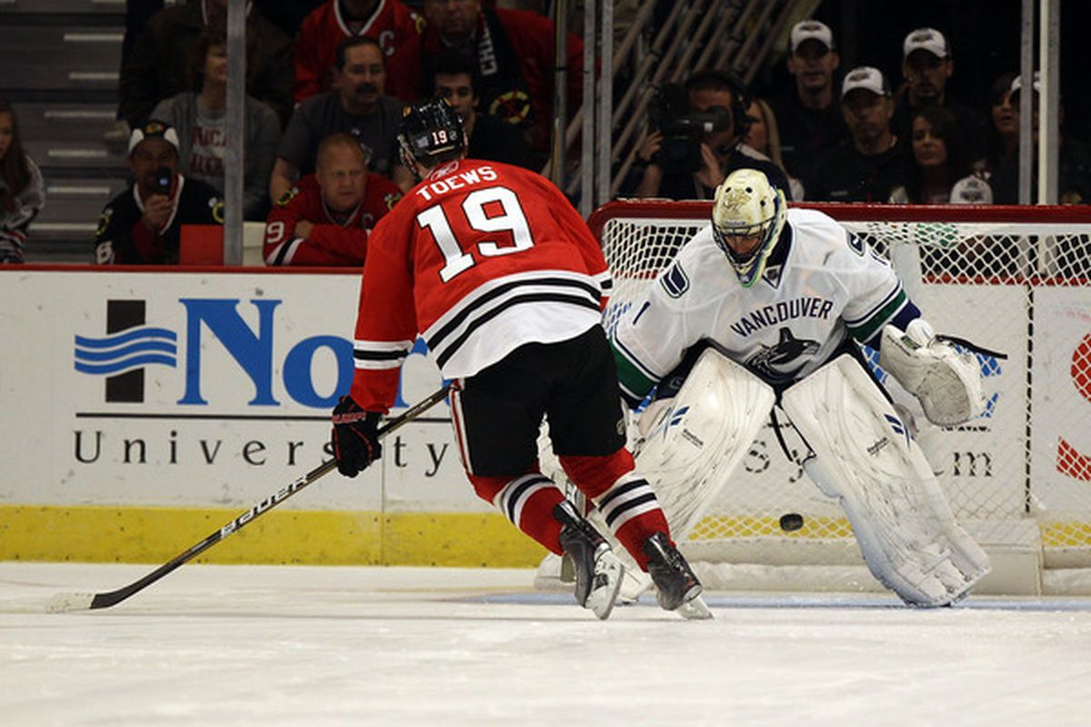 """It's understandable that Luongo could look this bad on Tazer's shootout goal, <a href=""""http://images3.cpcache.com/product/54875793v8_480x480_Front.jpg"""" target=""""new"""">Captain Marvel never really goes 5 hole.</a>"""