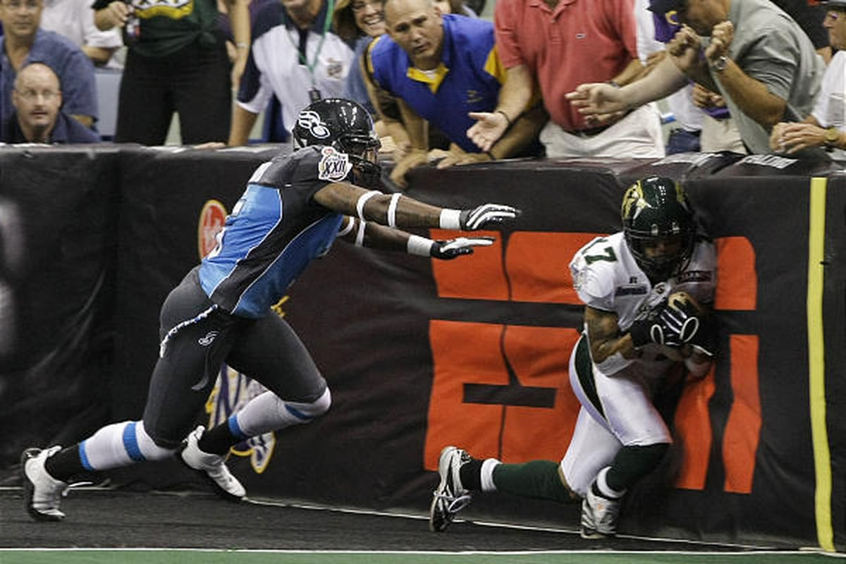 San Jose SaberCats wide receiver Rodney Wright catches a touchdown pass as Philadelphia Soul defensive back Dee Webb defends in the first half of the ArenaBowl football game in New Orleans last year.