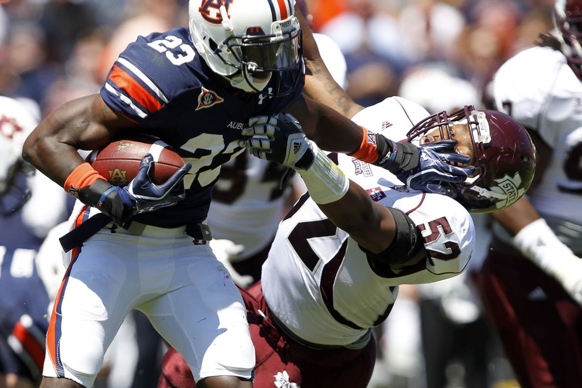<em>Tigers try to stiff-arm the Bulldogs once again! (Photo by Butch Dill/Getty Images)</em>