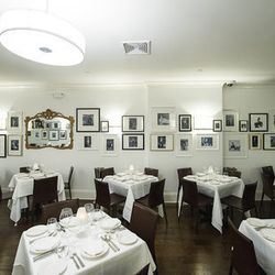 """<a href=""""http://ny.eater.com/archives/2012/10/a_look_around_the_very_white_il_mulino_uptown.php#5072f4a585216d444100b447"""">Eater Inside: Il Mulino Uptown</a>"""