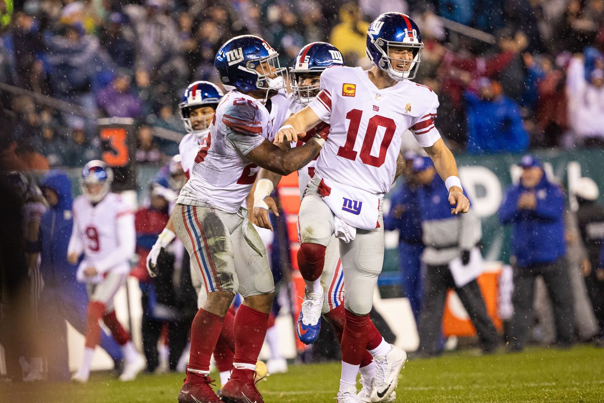 New York Giants quarterback Eli Manning celebrates with running back Saquon Barkley after his second touchdown pass of the game during the second quarter against the Philadelphia Eagles at Lincoln Financial Field.
