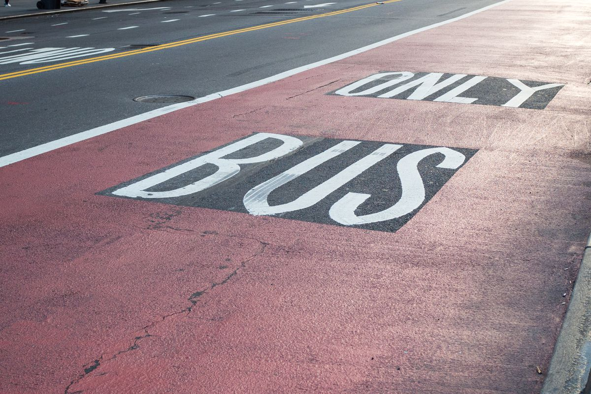 """A NYC busway painted in red and reads """"Only Bus."""""""