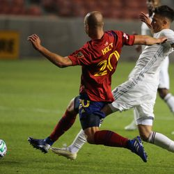 Colorado Rapids midfielder Cole Bassett (26) dribbles against Real Salt Lake defender Erik Holt (20) during an MLS soccer game at Rio Tinto Stadium in Sandy on Saturday, Sept. 12, 2020.