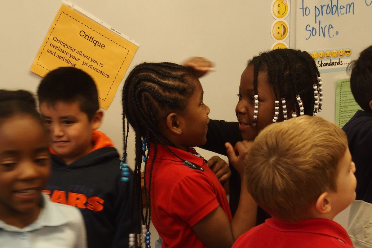 Kindergarten and first grade students in Treadwell Elementary's new gifted education class compare each other's height to get in line from shortest to tallest.