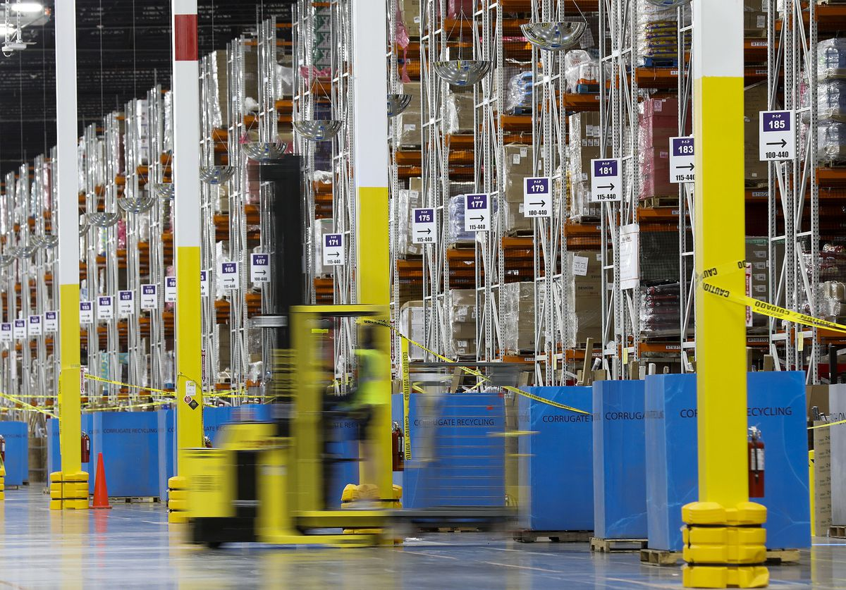 An employee works at the Amazon fulfillment center in South Jordan on Thursday, May 20, 2021.