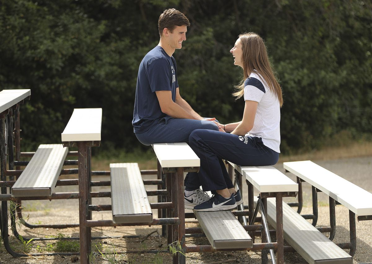 Zach and Kennedy Eschenberg chat at a park near their home in Bountiful on Friday, May 22, 2020. The two BYU volleyball players meet playing basketball and got married.