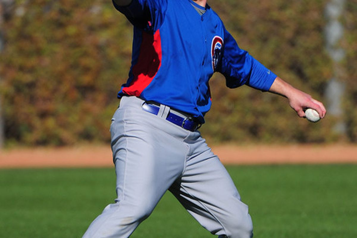 Mesa, AZ, USA; Chicago Cubs starting pitcher Paul Maholm throws the baseball during spring training at Fitch Park. Credit: Kyle Terada-US PRESSWIRE