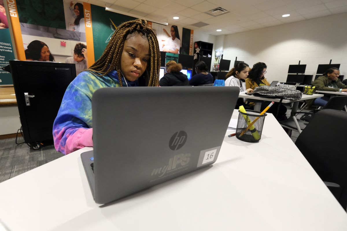 A student works at a laptop computer in a classroom at Crispus Attucks High School, a public school in Indianapolis, Indiana.
