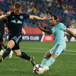 FOXBOROUGH, MA - APRIL 20: New England Revolution defender Edgar Castillo #8 sends in a cross during the first half at Gillette Stadium on April 20, 2019 in Foxborough, Massachusetts. (Photo by J. Alexander Dolan - The Bent Musket)