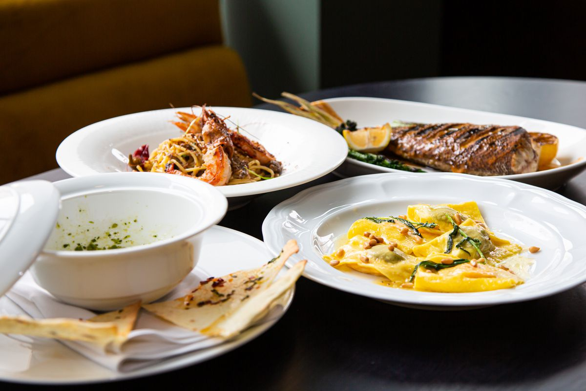A table with pasta, whole fish, crudite, and shrimp at Lyla Lila in Midtown, Atlanta