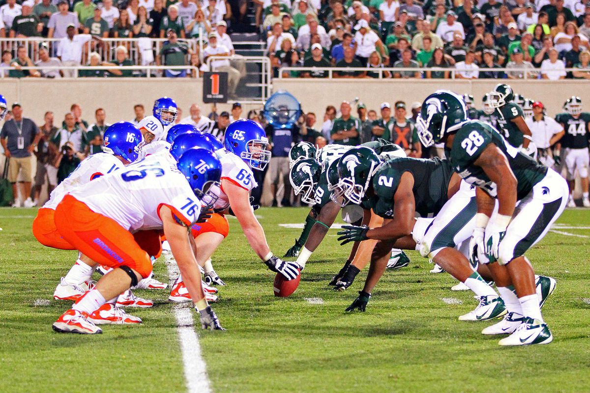 August 31, 2012; East Lansing, MI, USA; Michigan State Spartans and Boise State Broncos players line up at the line of scrimmage during the second half at Spartan Stadium. MSU won 17-13.    Mandatory Credit: Mike Carter-US PRESSWIRE