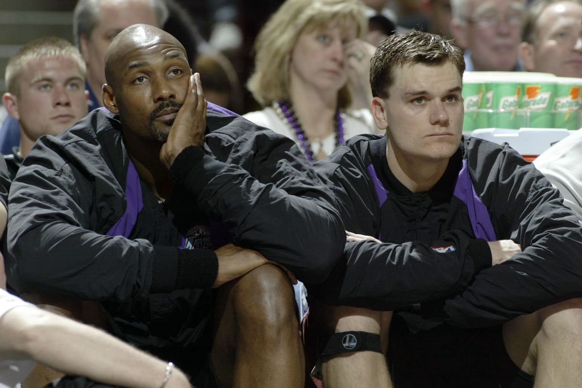Malone and Harpring on bench