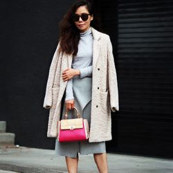 """Hallie of <a href=""""http://www.halliedaily.com """"target=""""_blank"""">Hallie Daily</a> is wearing a Salvatore Ferragamo bag and shoes, a Zara skirt, an H&M coat, a Gap sweater and <a href=""""http://www.revolveclothing.com/DisplayProduct.jsp?product=KWAL-WG5&utm_s"""