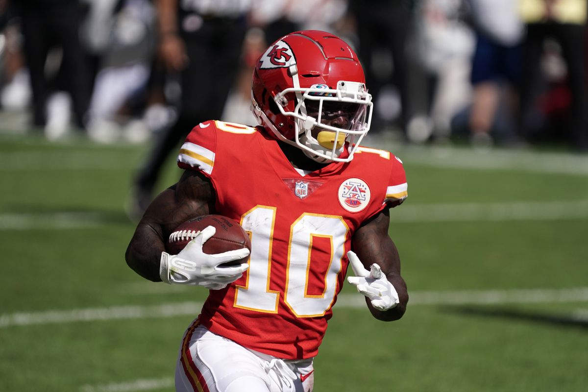 Kansas City Chiefs wide receiver Tyreek Hill (10) scores on a 10-yard touchdown run in the second quarter against the Las Vegas Raiders