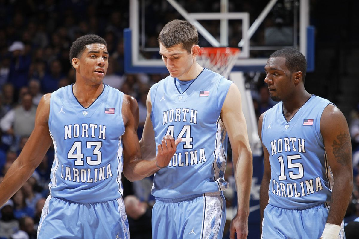 James Michael McAdoo, Tyler Zeller and P.J. Hairston talk over strategy during the game against the Kentucky Wildcats at Rupp Arena.