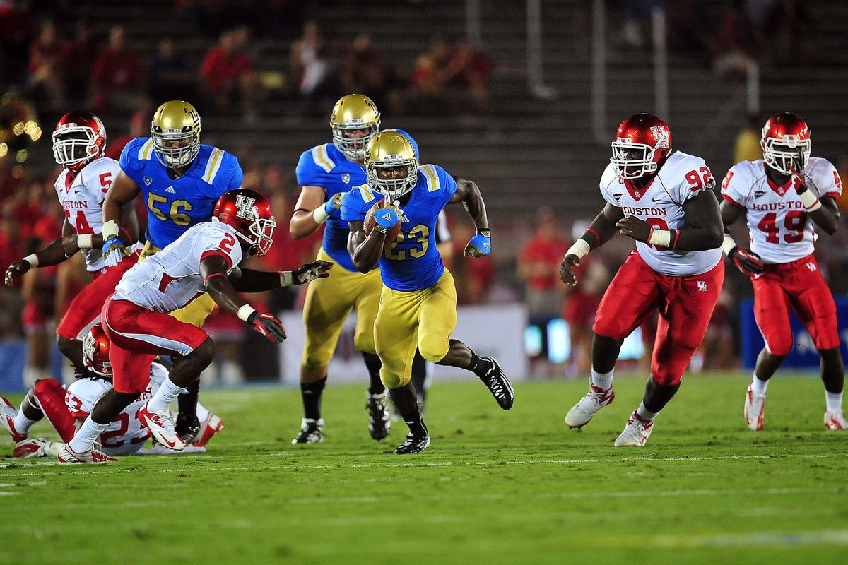 September 15, 2012; Pasadena, CA, USA; UCLA Bruins running back Johnathan Franklin (23) runs the ball against the Houston Cougars during the the game at the Rose Bowl. Mandatory Credit: Gary A. Vasquez-US PRESSWIRE