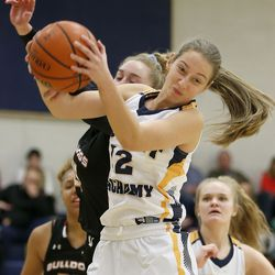 Summit Academy's Kyrie Alldredge (12) rebounds the ball against Judge Memorial's Emily Malouf (25) at Summit Academy in Bluffdale on Thursday, Jan. 9, 2020.