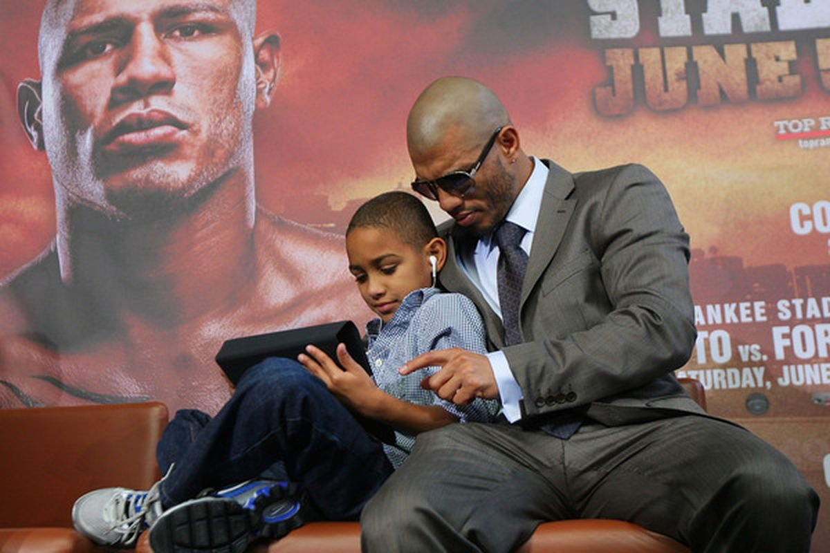NEW YORK - JUNE 02:  Miguel Cotto and his son Miguel Jr. look on prior to the start of the Foreman v Cotto press conference on June 2, 2010 at Yankee Stadium in the Bronx borough of New York City.  (Photo by Mike Stobe/Getty Images)