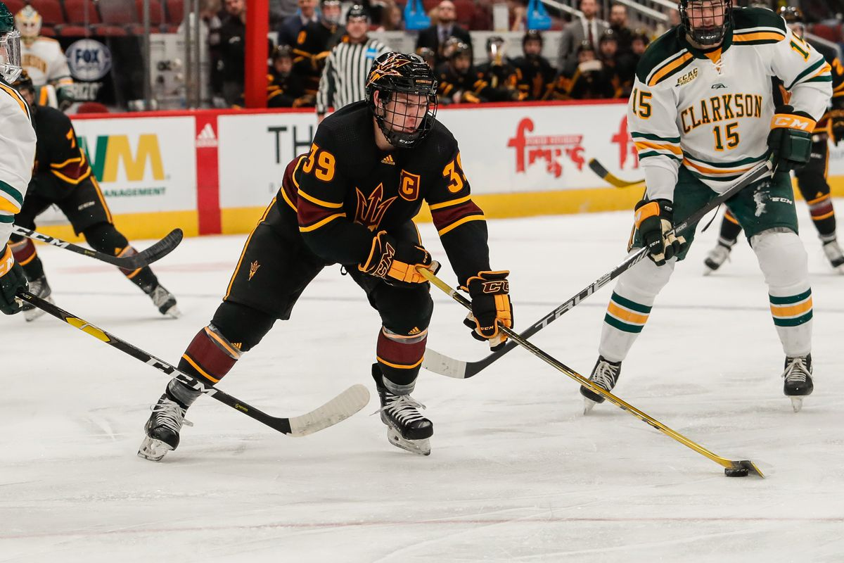 Arizona State Sun Devils defenseman Brinson Pasichnuk (39) controls the puck during the college hockey game between the Clarkson Golden Knights and the ASU Sun Devils on December 28, 2018 at Gila River Arena in Glendale, Arizona.