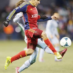 Real's Tony Beltran tries to kick the ball with Kansas City's Graham Zusi defending Saturday, Dec. 7, 2013 in MLS Cup action. Sporting KC won in a shootout.