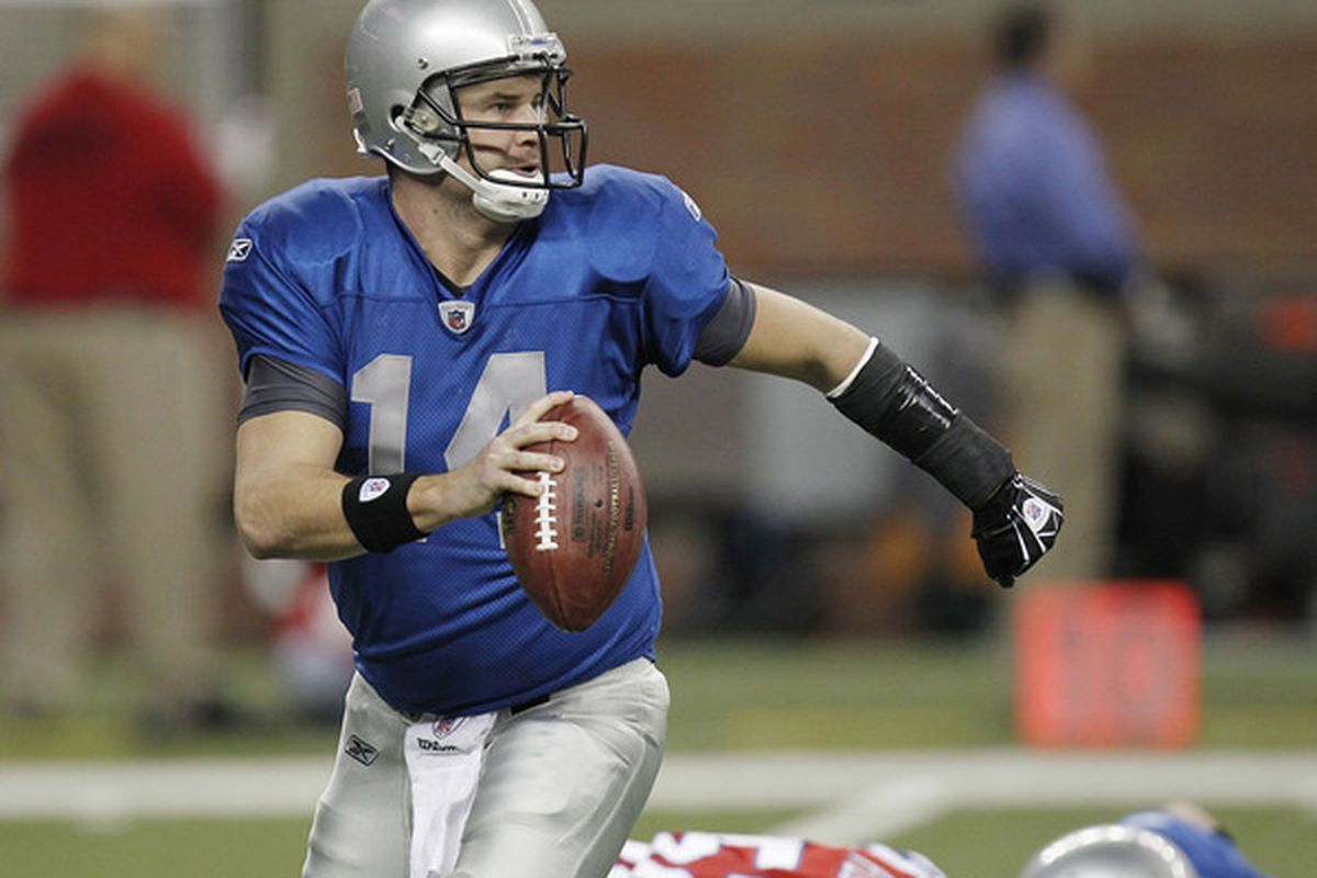 DETROIT - NOVEMBER 25:  Shaun Hill #14 of the Detroit Lions looks for a open reciever while playing the New England Patriots on November 25 2010 at Ford Field in Detroit Michigan.  (Photo by Gregory Shamus/Getty Images)