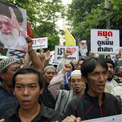 Thai-Muslim men hold banners and chant slogans while marching on a street during a demonstration outside the U.S. Embassy in Bangkok, Thailand, Tuesday, Sept. 18, 2012. About 400 Muslim people have protested peacefully outside the embassy against an anti-Islam video produced in the United States that has sparked demonstrations in many Muslim countries.