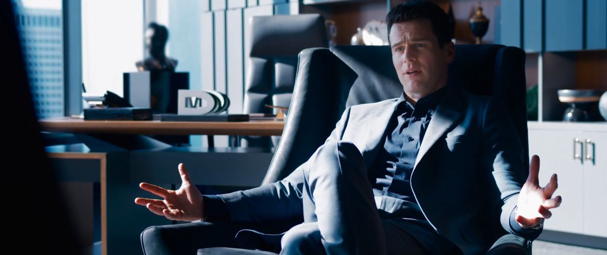 Jonathan Groff as some guy sitting in a nice office in The Matrix Revolutions