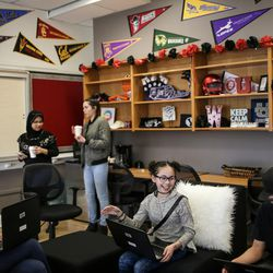 Daniela Rodriguez, 12, left, Myya Min, 18, Laila Reyes, 18, Maya Devries, 12, and Arturo Martinez, 13,  hang out and study in the Our CASA space at West High School in Salt Lake City on Friday, Feb. 24, 2017. Our CASA spaces are part of an initiative to increase access to higher education for first-generation students and their families on Salt Lake City's west side. The younger students are part of the Extended Learning Program that allows middle schoolers to take high school courses.