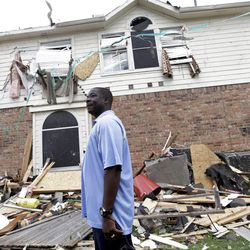 """Charles Paige stands amongst tornado debris as he surveys the damage to his home Wednesday, April 4, 2012, in Forney, Texas. The mayor of Forney, Texas, says it's """"a real blessing"""" that nobody was killed in the community by the tornadoes that ripped through parts of the Dallas area yesterday (AP Photo/Tony Gutierrez)"""