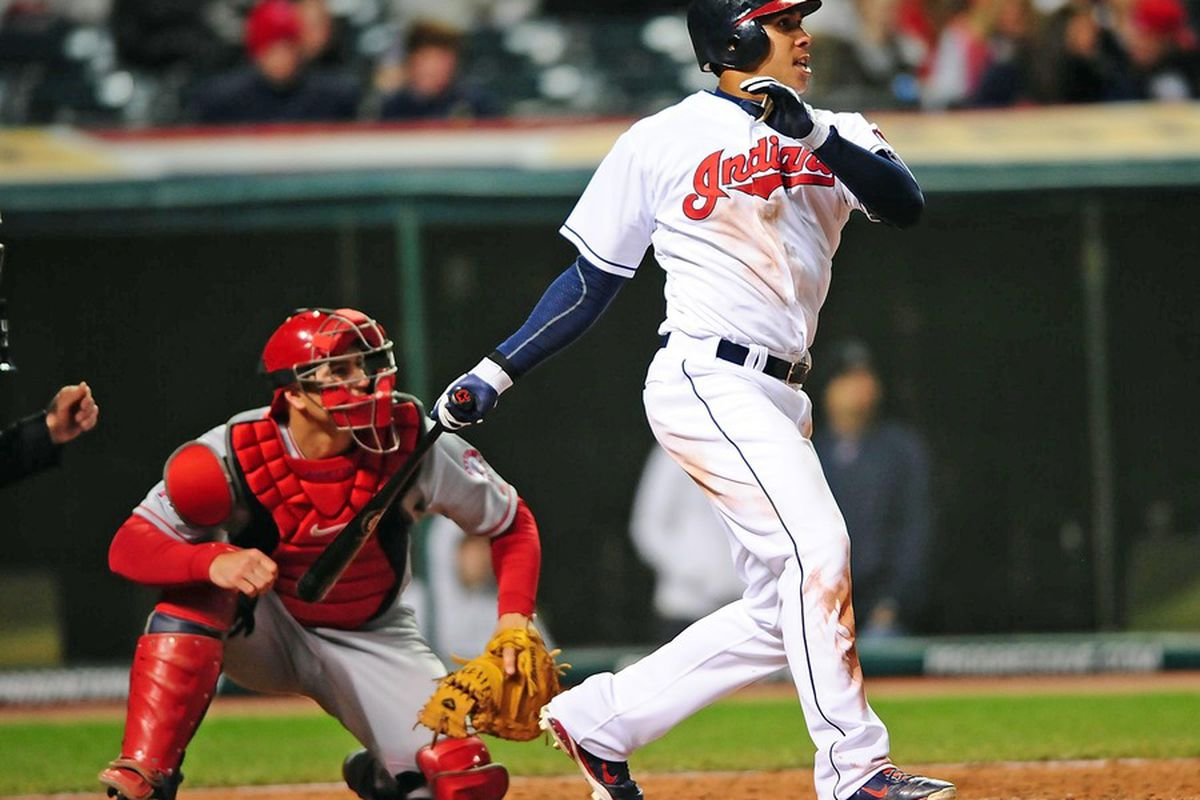 April 27, 2012; Cleveland, OH, USA; Cleveland Indians left fielder Michael Brantley (23) hits a double in the seventh inning against the Los Angeles Angels at Progressive Field. Mandatory Credit: Andrew Weber-US PRESSWIRE