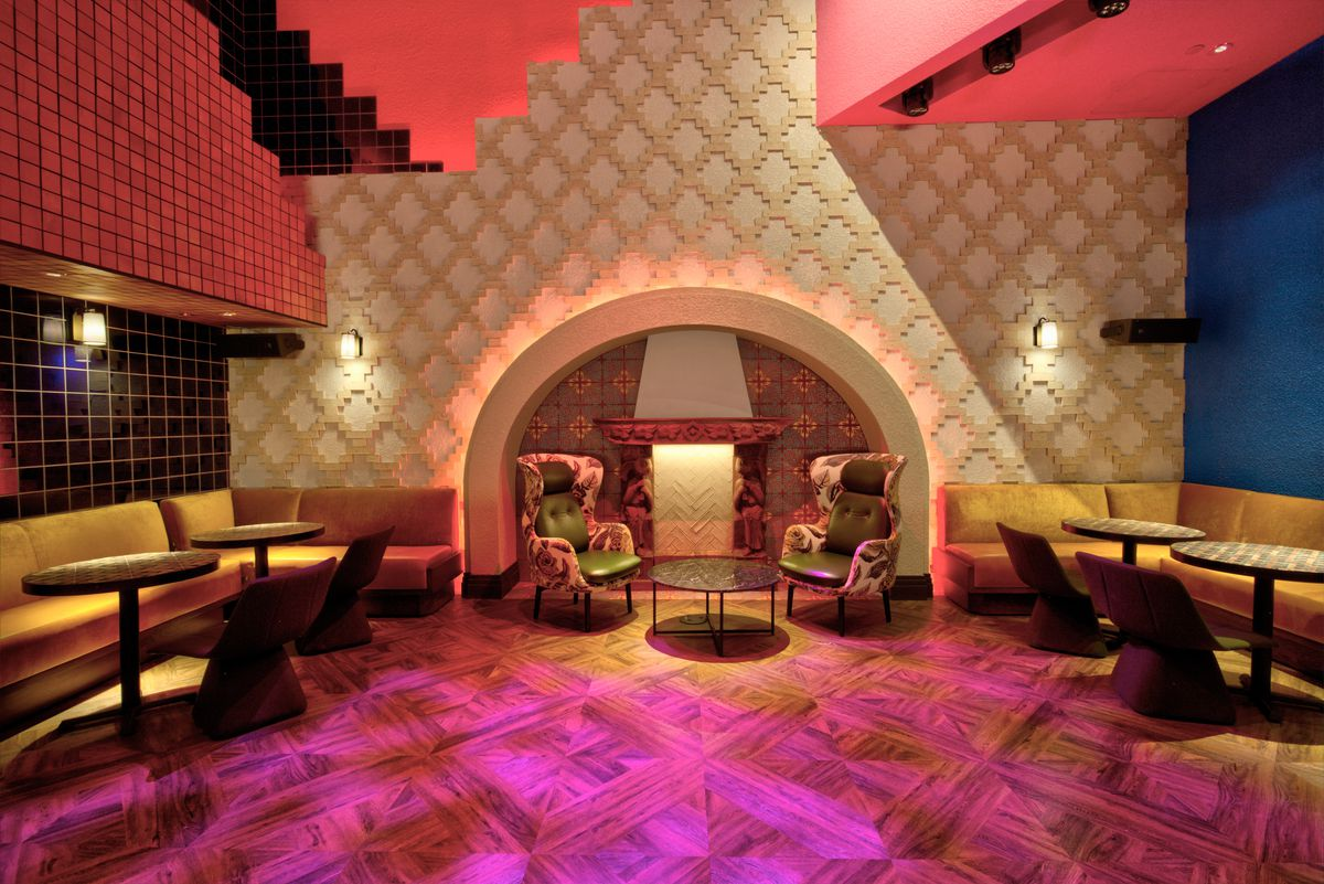 A fireplace sits in front of a dance floor