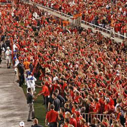 Fans on sidelines at the end of the game as the University of Utah defeats BYU 24-21 in football Saturday, Sept. 15, 2012, in Salt Lake City, Utah.