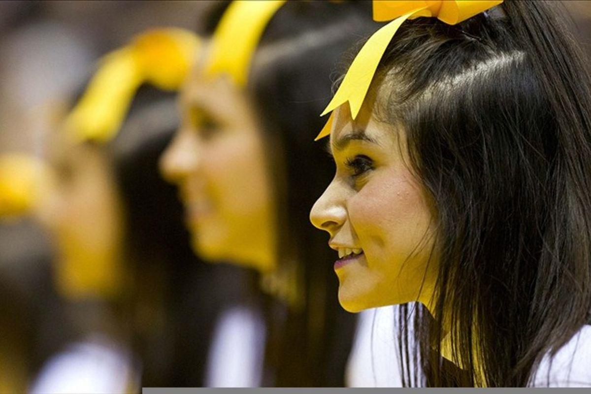 Mar 3, 2012; Milwaukee, WI, USA; Marquette Golden Eagles cheerleaders perform during the second half against the Georgetown Hoyas at the Bradley Center.  Marquette defeated Georgetown 83-69.  Mandatory Credit: Jeff Hanisch-US PRESSWIRE