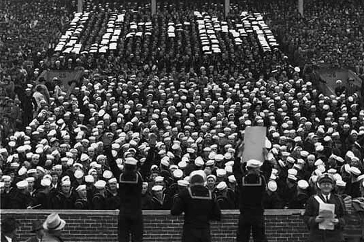 Navy boys leading a card stunt at Memorial Stadium in 1942