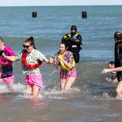 Over 5,000 people took part in the 18th Annual Polar Plunge Sunday, March 4, at North Avenue Beach.   Erin Brown/Sun-Times