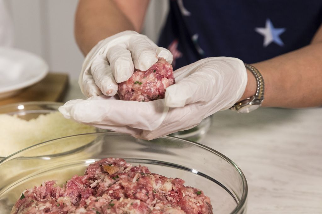 Molding meatballs with three different types of meat.   Ashlee Rezin/Sun-Times