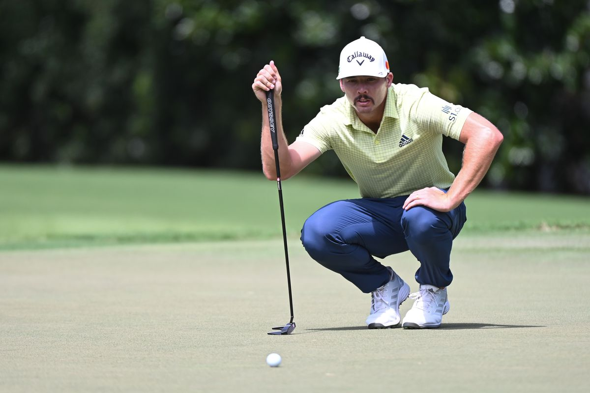 Sam Burns lines a putt on the 2nd green during the second round of the Tour Championship golf tournament.