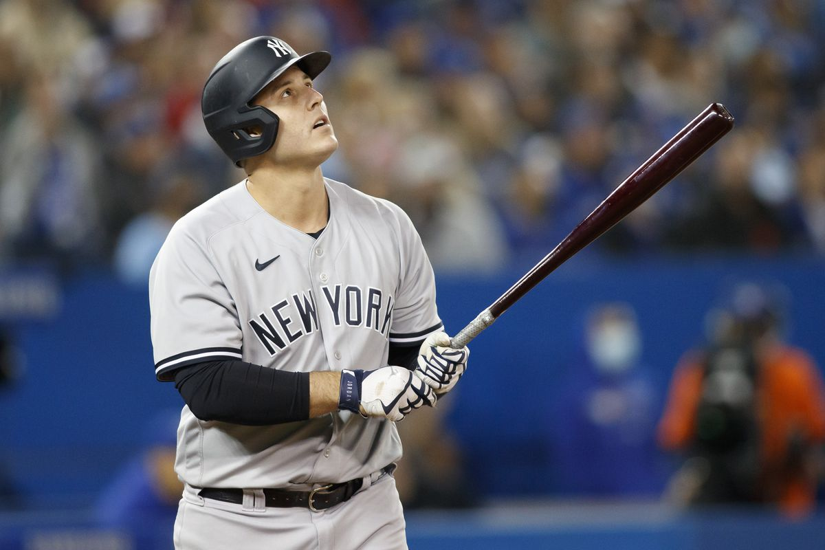 Anthony Rizzo #48 of the New York Yankees hits a solo home run the sixth inning of their MLB game against the Toronto Blue Jays at Rogers Centre on September 30, 2021 in Toronto, Ontario.