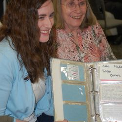 Joella Peterson and her mother, Lucy, display the family recipe book that Joella created for a 4-H project when she was 9.
