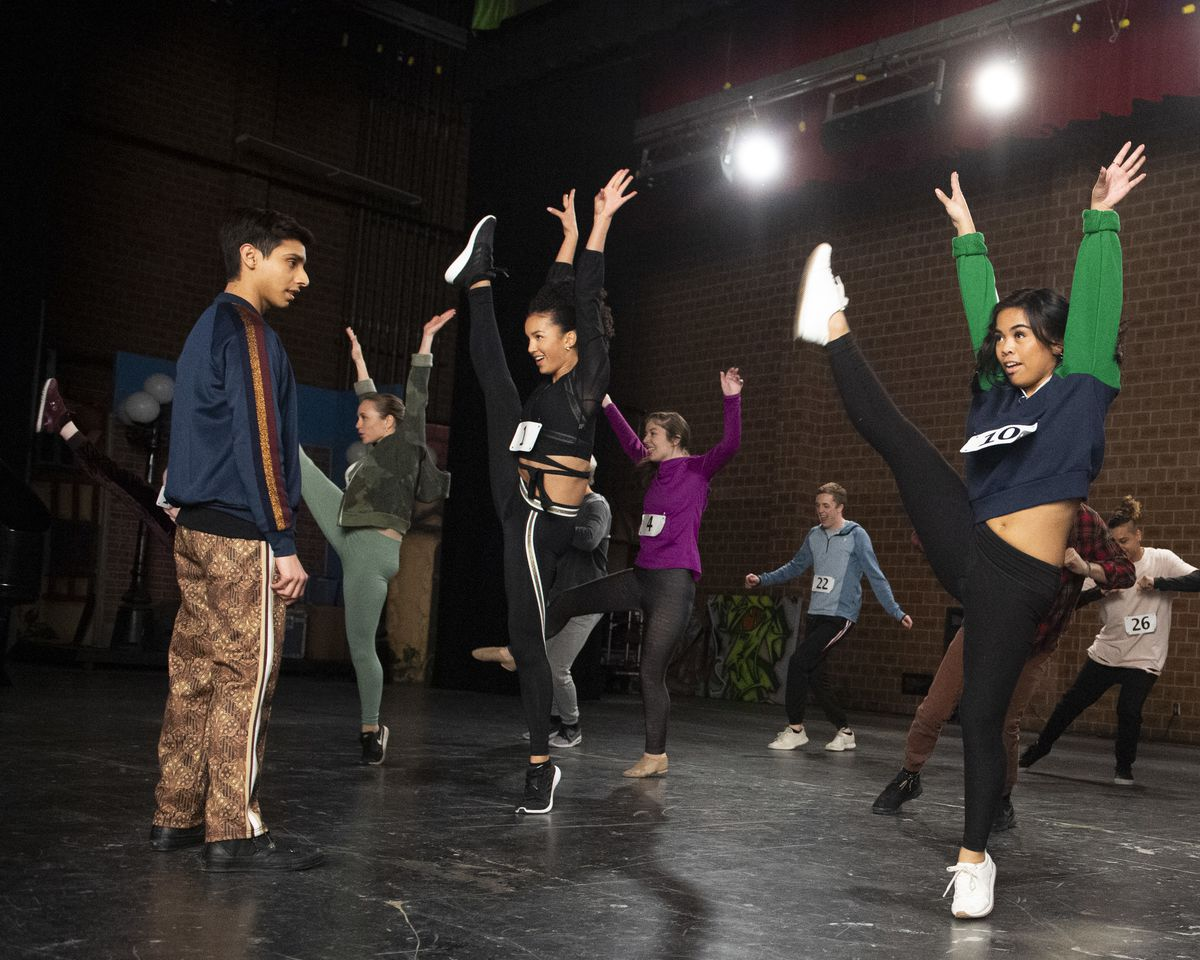 a group of students dances during auditions