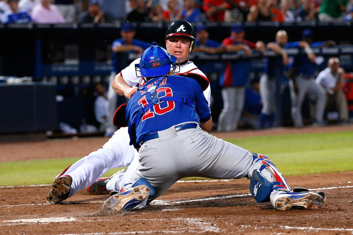ATLANTA, GA - JULY 04:  Geovany Soto #18 of the Chicago Cubs tags out Chipper Jones #10 of the Atlanta Braves at homeplate in the sixth inning at Turner Field on July 4, 2012 in Atlanta, Georgia.  (Photo by Kevin C. Cox/Getty Images)