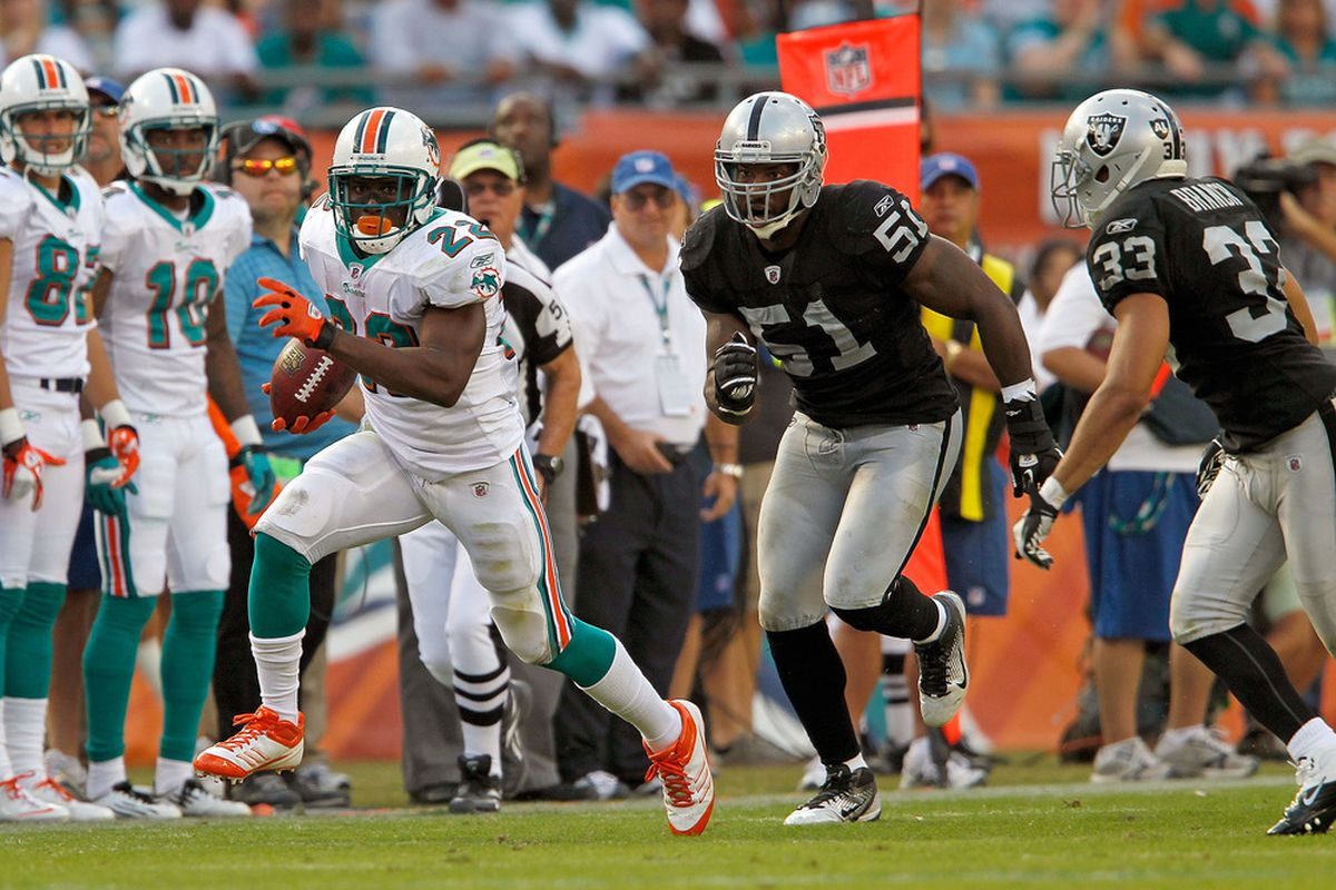 MIAMI GARDENS, FL - DECEMBER 04:  Reggie Bush #22 of the Miami Dolphins rushes during a game against the Oakland Raiders at Sun Life Stadium on December 4, 2011 in Miami Gardens, Florida.  (Photo by Mike Ehrmann/Getty Images)