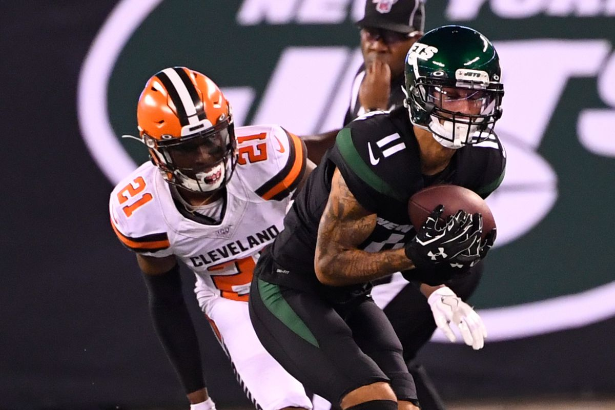 New York Jets wide receiver Robby Anderson makes a catch in front of Cleveland Browns cornerback Denzel Ward in the second half at MetLife Stadium.