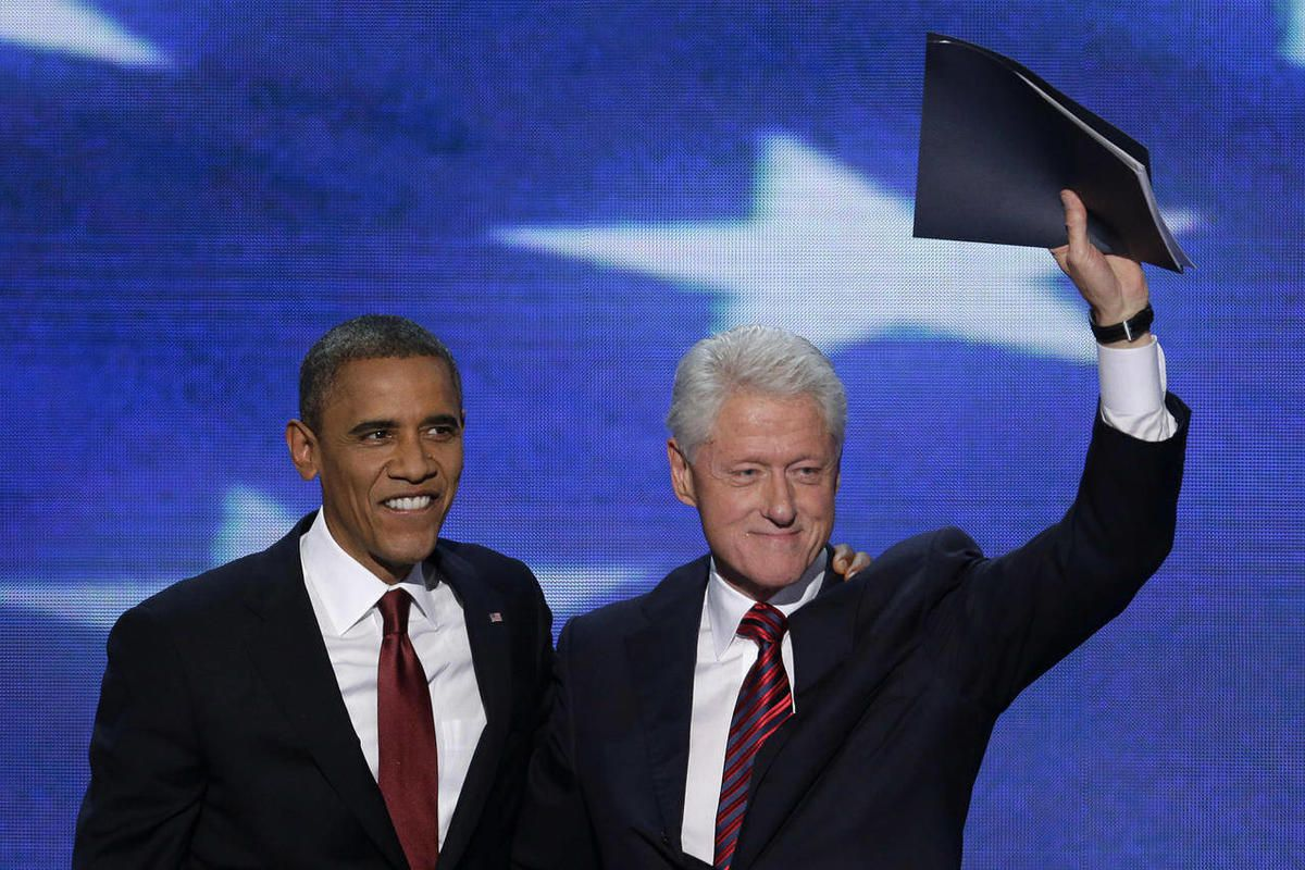 Former President Bill Clinton waves to the delegates as he stands with President Barack Obama after Clinton addressed the Democratic National Convention in Charlotte, N.C., on Wednesday, Sept. 5, 2012.