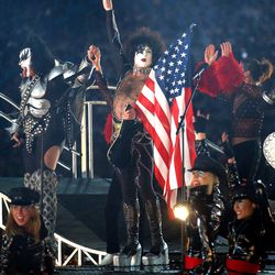 Gene Simons, left, and Paul Stanley of KISS, wave to the crowd after performing at the Salt Lake 2002 Winter Games closing ceremony at the University of Utah's Rice-Eccles Stadium Sunday, Feb. 24, 2002.