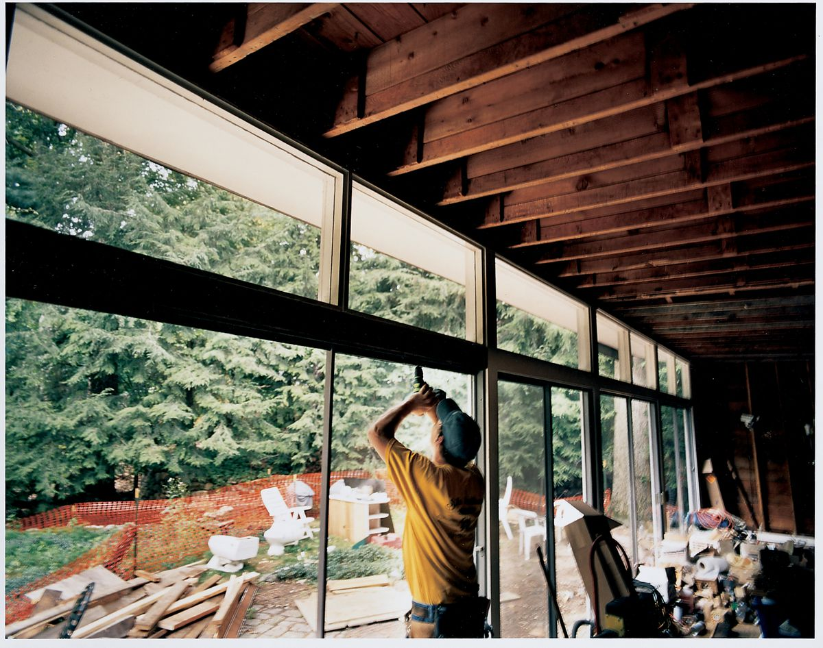 <p>George Mabry's kitchen and living room afford him broad views of his leafy backyard, the feature that most attracted him to the property. Low-E coatings on the glass will cut down the heat in winter and broiling sun in summer.</p>