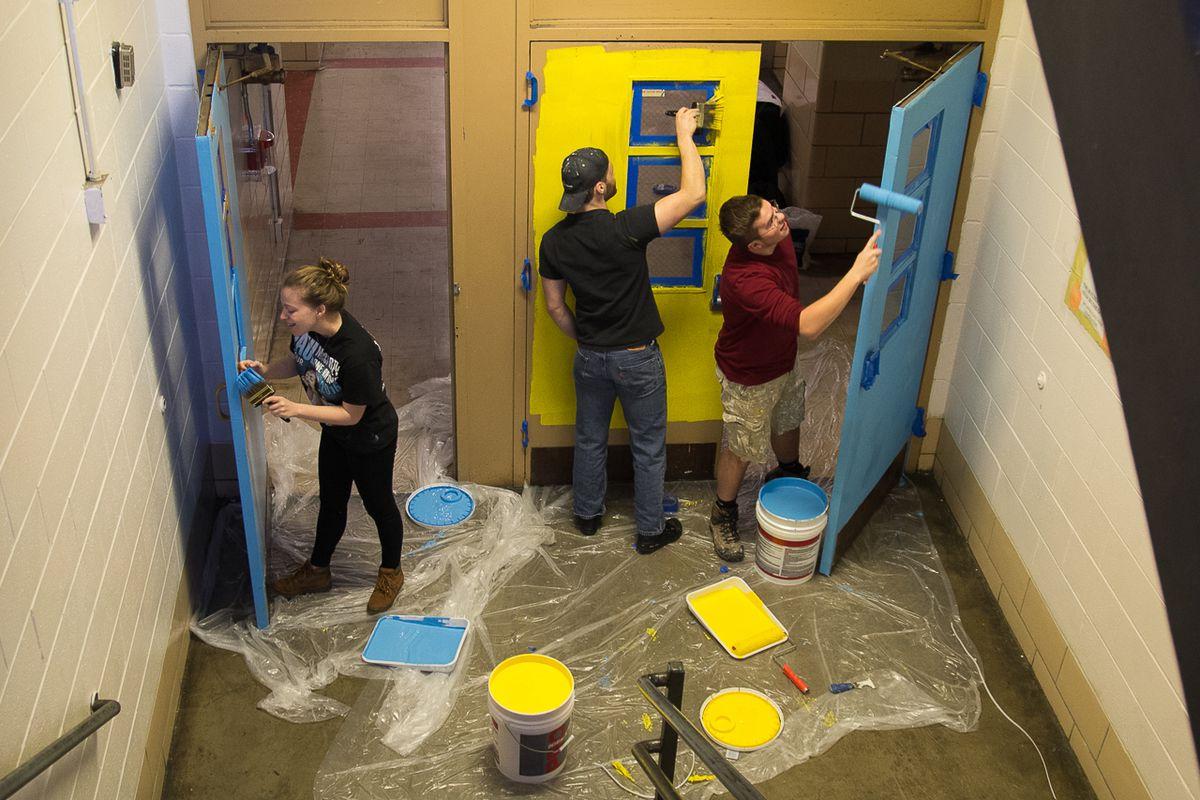 Volunteers painting at McMichael school.