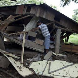 Wilber Sequeira searches for recoverable items in his earthquake damaged home in Nosara, Costa Rica, Thursday, Sept. 6, 2012. A powerful, magnitude-7.6 earthquake shook Costa Rica and a wide swath of Central America on Wednesday.