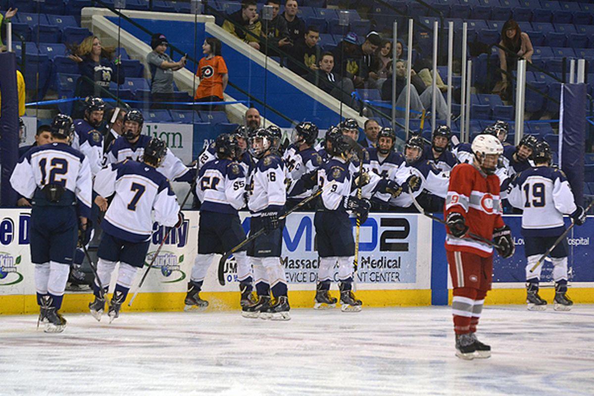 Malden Catholic players celebrate a goal in last week's quarterfinal series against Catholic Memorial.